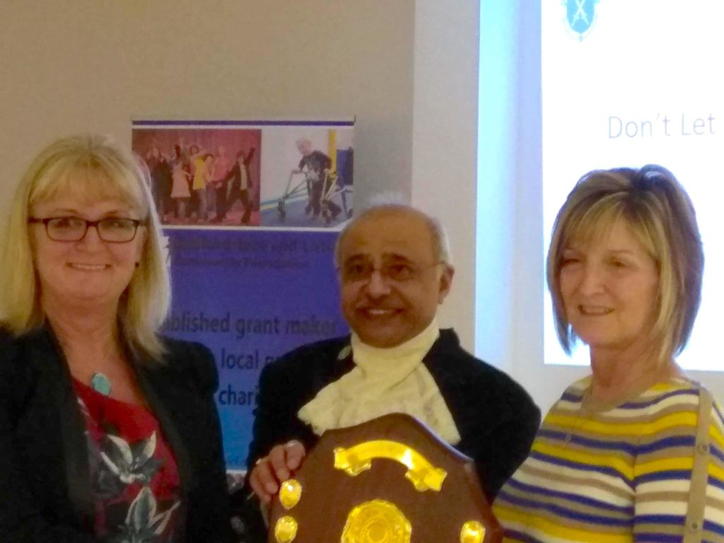 Cofounders and trustees of DLDD Sharon Knott and Sharon Warboys accepting the High Sheriff of Bedfordshire Award from High Sheriff Vinod Taylor.